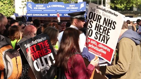 BRISTOL - May 13: Protest Against Conservative Government & Healthcare Cuts: 'NHS is Here to Stay' Sign on May 13, 2015 in Bristol, England.