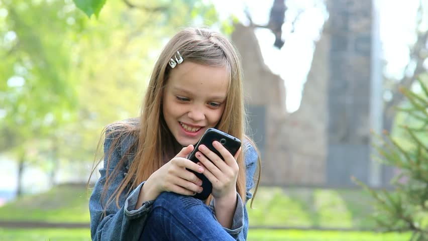 Image result for kid using phone outside