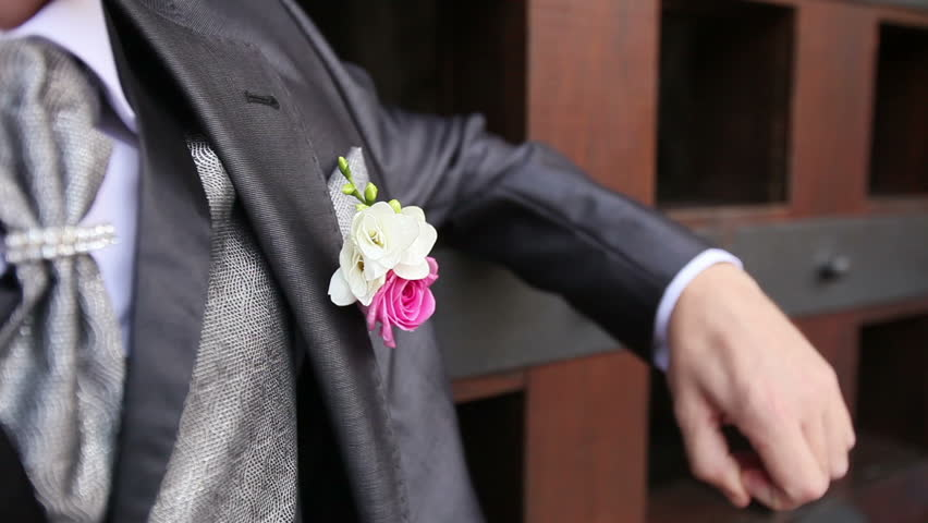 Groom In Grey Wedding Suit With Flower Small Chest Pocket Snaps His Fingers Stock Footage Video 10015736 Shutterstock