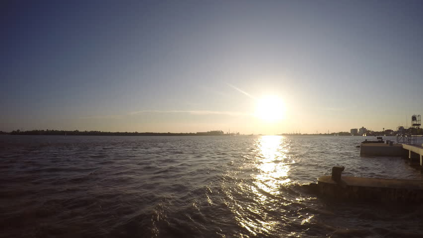 Sunset And River View Have Cargo Ships Pass Out Through The Rivertime Lapse