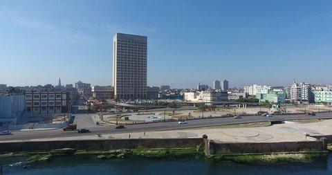 Drone flying over Havana, Cuba: Hermanos Ameijeiras Hospital, Caribbean sea, Malecon promenade.