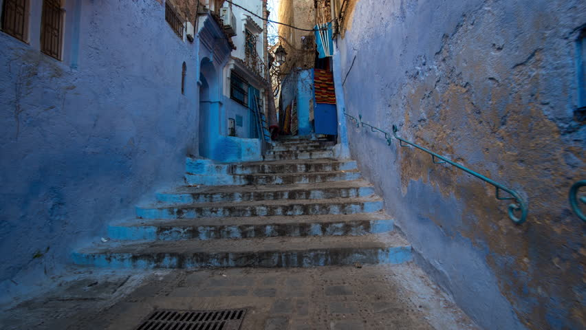 Day hyperlapse cityscape old typical blue Chefchaouen Morocco traffic people old historical Medina | Shutterstock HD Video #1005621496