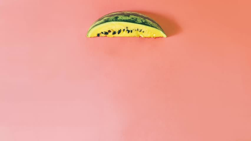 from a piece of yellow watermelon the rain is pouring. surreal and fantasy. minimal art