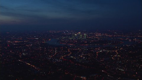 AERIAL United Kingdom-Canary Wharf At Night 2005: Magic hour shot approaching Isle of Dogs from south Greenwich