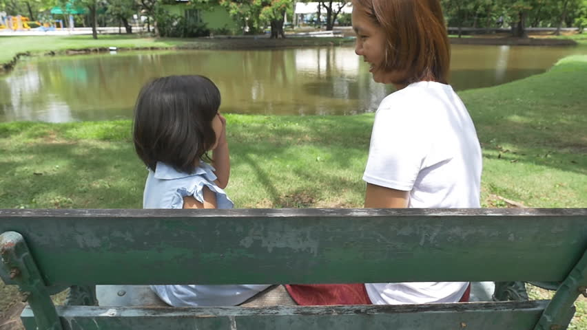Family moment, little Asian girl playing with mother together in the park | Shutterstock HD Video #10065086