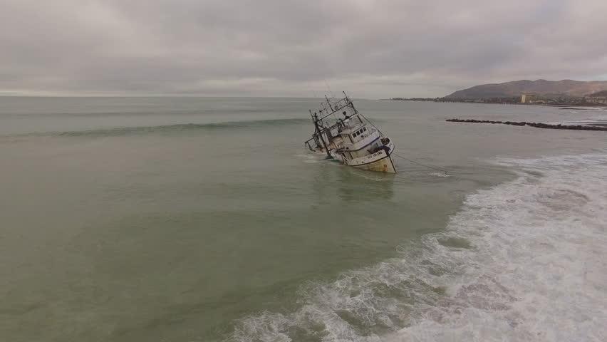 VENTURA, CALIFORNIA - CIRCA 2010s - Aerial shot over a shipwrecked fishing boat near Ventura, California.