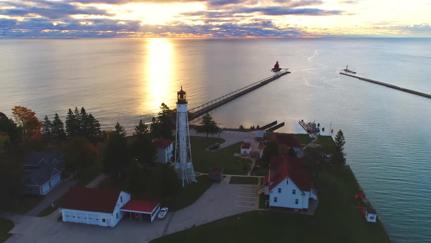 Aerial view of amazing Great Lakes sunrise with two lighthouses.