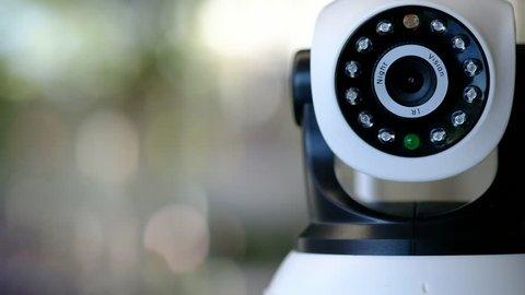 Indoor a Cctv IP wireless Security Camera with rotating head and infrared, CCTV security camera, Remote controlled IP camera for home, Close up, Select focus.