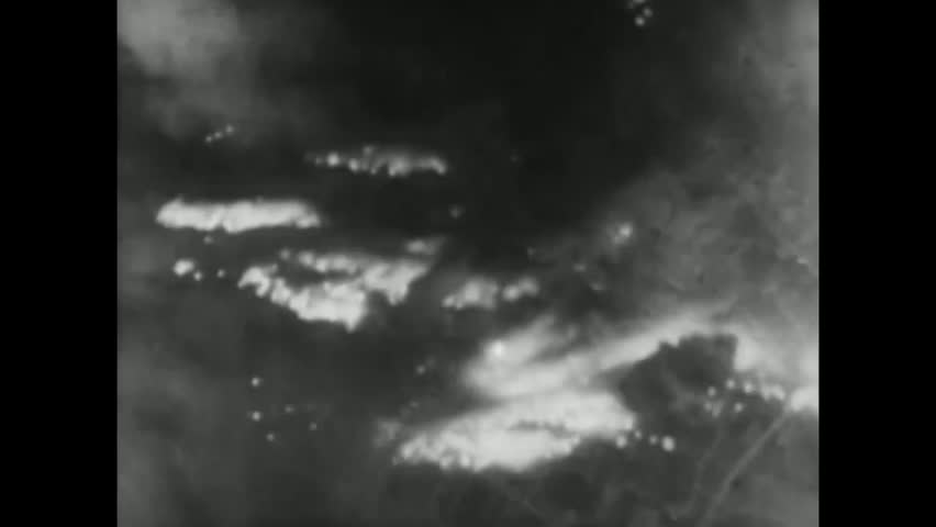 CIRCA 1944 - The 21st Bomber Command bombs Tokyo, Japan at night in World War 2.