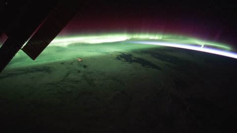 Beautiful and spectacular zoom in of time lapse Aurora Borealis over Canada from satellite at out space. Earth maps and images courtesy by Nasa.