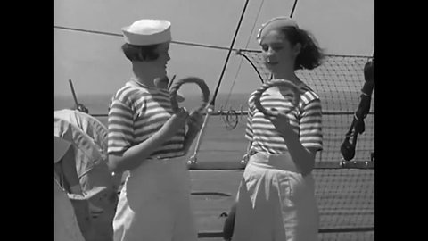CIRCA 1930s - Cruise liner passengers swim and play games in a deck swimming pool, in 1934.