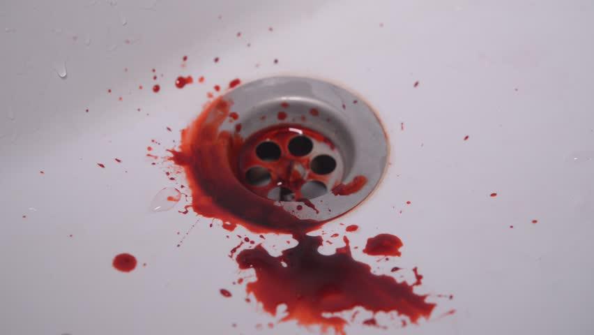 Blood dripping into sink   Shutterstock HD Video #1006776856