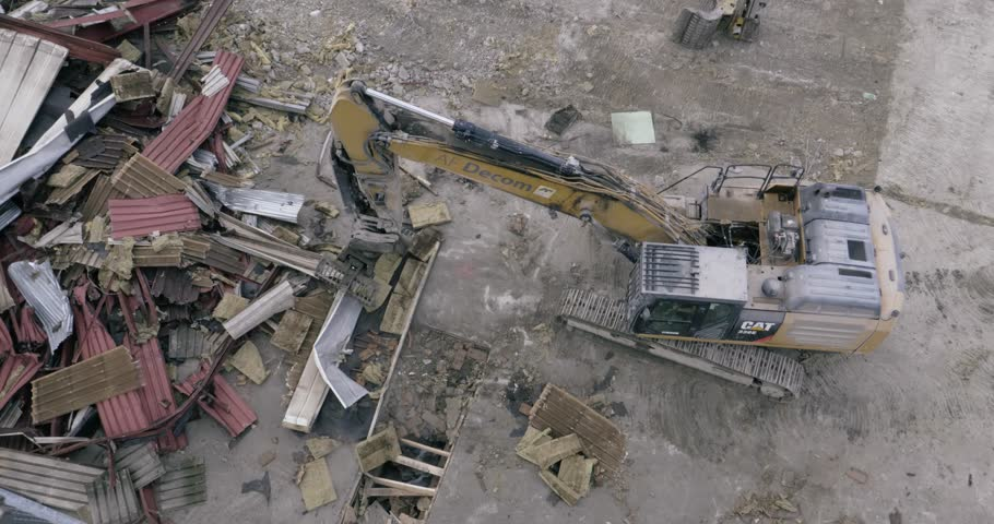 Tromso, Norway: October 1, 2017:Wrecking machine excavator claw sorts - demolished materials recycling | Shutterstock HD Video #1006792366