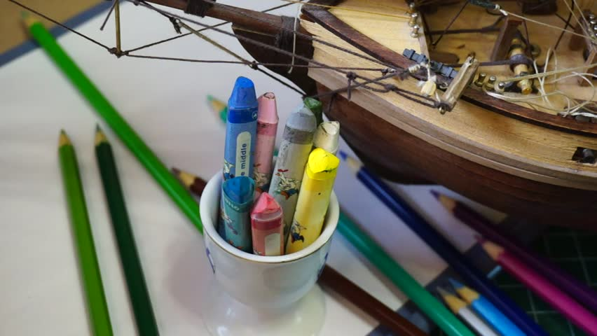 The Creative Producer S Desktop With Ship And Pencils Direct Movement Of Camera