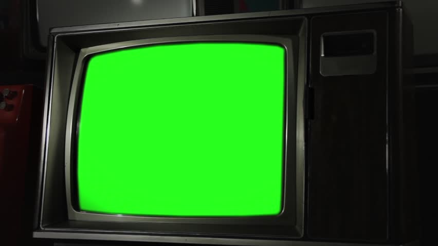 "Old Retro TV with Green Screen and Wooden Style. Zoom In. You can Replace Green Screen with the Footage or Picture you Want with ""Keying"" effect in After Effects (check out tutorials on YouTube).  