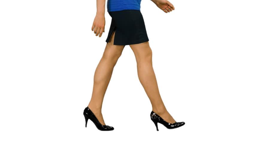 Elegant female legs walking in black mini skirt and shoes on heels, alpha channel