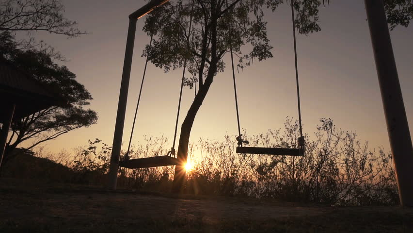 Slow motion, Empty swing set swing, silhouette at sunset.  | Shutterstock HD Video #1006842826