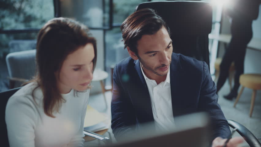 Group of two business person at working process.Young professionals work with new market project. Blurred background | Shutterstock HD Video #1006858756