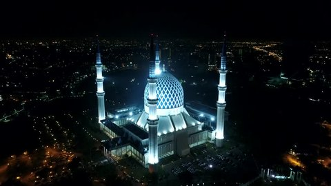 Aerial 4k night view of Sultan Salahuddin Abdul Aziz Shah Mosque (also known as the Blue Mosque) located at Shah Alam, Selangor, Malaysia