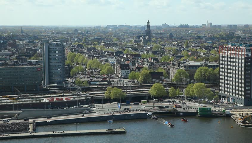 AMSTERDAM, NETHERLANDS - APR 11, 2017 : Panoramic view of Amsterdam. Cityscape with famous canals. Port and Central railway station. Top view from A'dam Tower.  | Shutterstock HD Video #1006968526