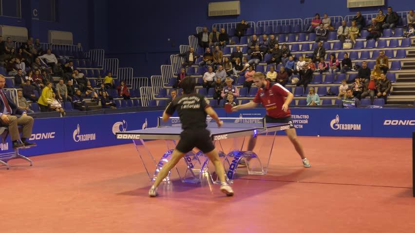 "Orenburg, Russia-September 28, 2017: boy compete in the European Champions League match ping pong ""torch-Gazprom, Russia and"" K.s. DARTOM DJGORIA GRODZISR, Poland."