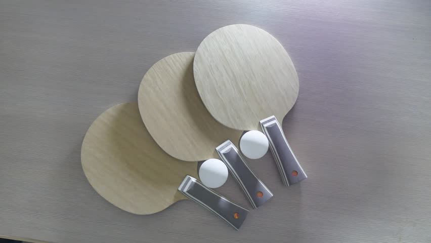 Table tennis rackets blade lies on the table. professional indoors table tennis rackets blade made of wood | Shutterstock HD Video #1007056696