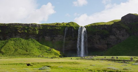 Iceland Waterfall Seljalandsfoss in Beautiful Icelandic Landscape. Famous tourist attraction and natural landmark destination on the ring road. RED EPIC SLOW MOTION.