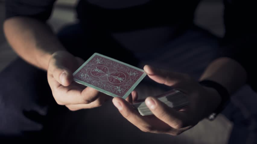 Close-up of a Magician's Hands Performing Card Trick. Card spinning on my finger.