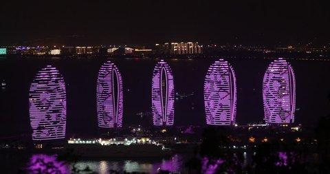 Night light shows on the walls of the hotel complex Phoenix on the island of Hainan in Sanya. China, Hainan Sheng, Sanya Shi, Tianya Qu, Jiangang Rd., November 8, 2017. EDITORIAL