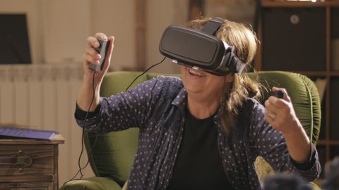 Middle aged woman trying virtual reality headset