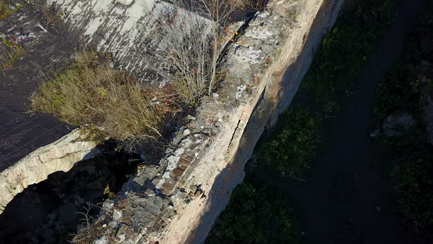 Aerial view of Wall of an old fortress with windows and doors | Shutterstock HD Video #1007152096