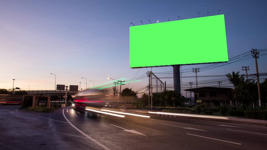 Advertising billboard green screen on sidelines of expressway with traffic at evening, time lapse. | Shutterstock HD Video #1007181676