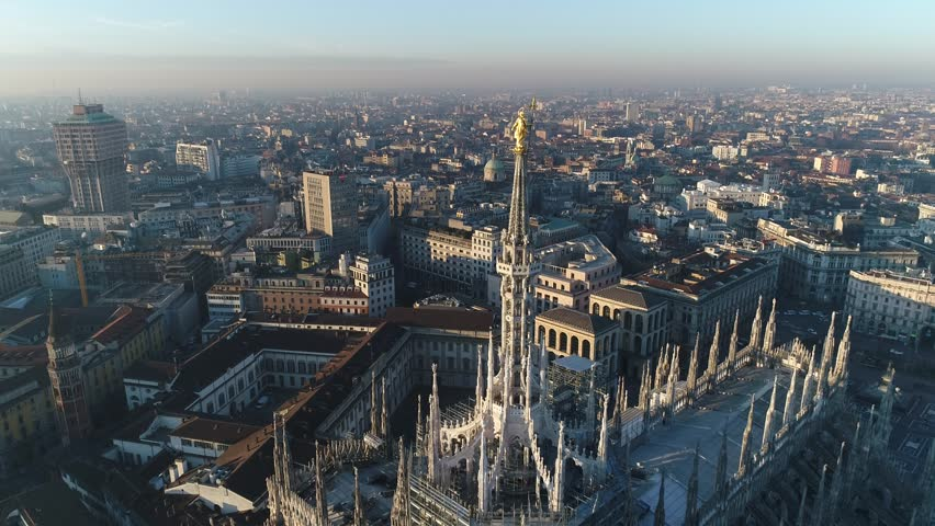 Aerial drone footage of famous statue on cathedral Duomo of Milan Italy // no video editing | Shutterstock HD Video #1007213716