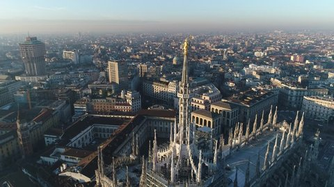 Aerial drone footage of famous statue on cathedral Duomo of Milan Italy // no video editing