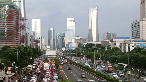 Time lapse of traffic rushing along the Gatot Subroto highway in the heart of Jakarta business district in Indonesia capital city. Jakarta is famous for its traffic jam and overcrowded streets.
