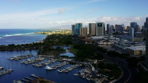 This video features a time-lapse of a passing rainstorm and rainbows at Ala Moana Harbor and the Honolulu cityscape on Oahu, Hawaii.