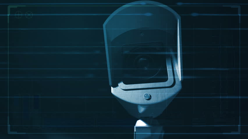 A closeup of a wireless surveillance camera with a blinking red illuminated light rotating in various directions in security surveillance overlaid with a technical analysis interface | Shutterstock HD Video #1007313406