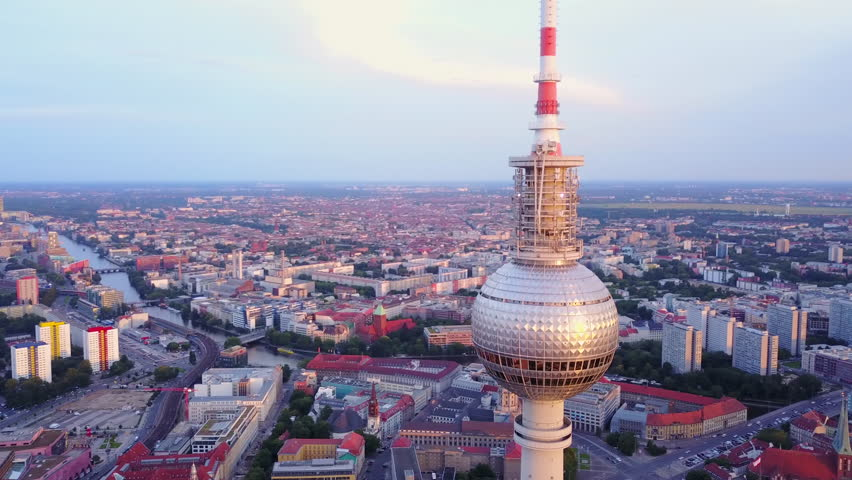 Germany Berlin Aerial v31 Flying low around Berliner Fernsehturm tower cityscape views sunset 8/17 | Shutterstock HD Video #1007318716
