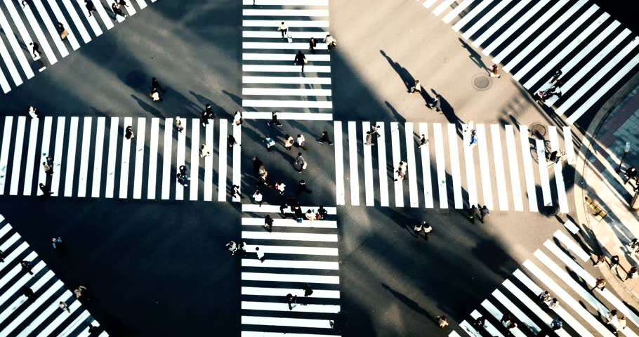 Aerial view of the Ginza cross from above, while people  crossing