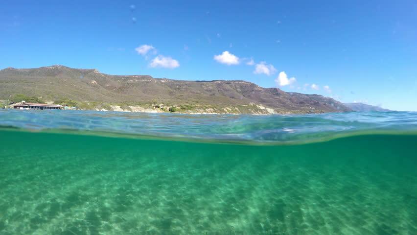 Split underwater view in Alghero turquoise sea. Sardinia, Italy