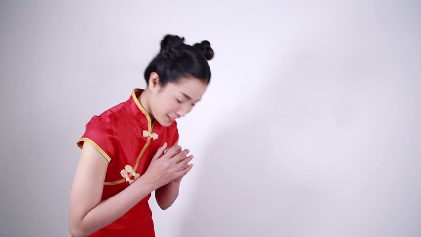 woman wear red cheongsam with gesture of congratulation in concept of happy chinese new year