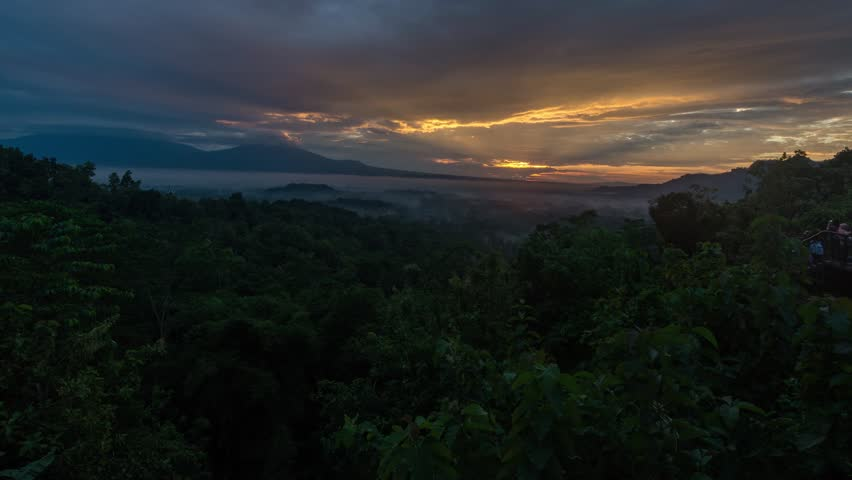 Time Lapse of view to Gunung Merapi, Merbabu, Borobudur from Punthuk Setumbu viewpoint near Yogyakarta city, Central Java, Indonesia