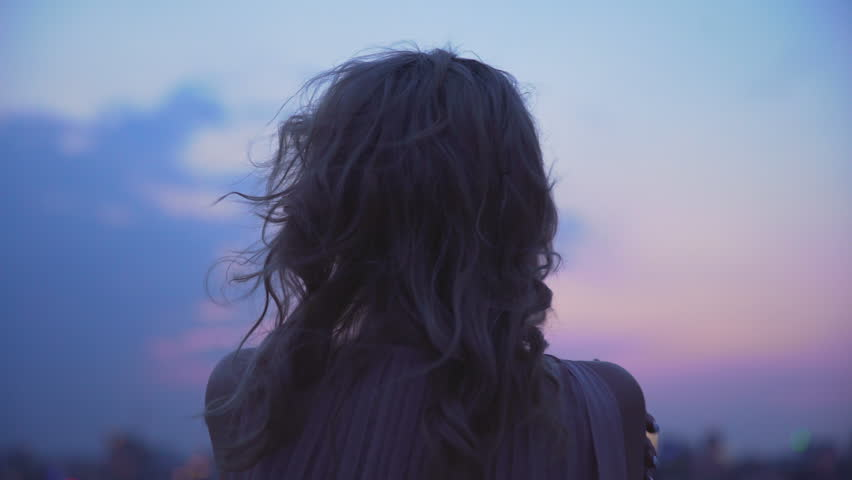 Lonely girl shaking from cold wind, standing on edge of roof, loneliness