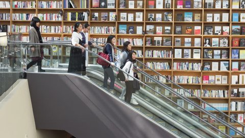 Seoul, South Korea - October 14, 2017: Escalator at Starfield Library. Visitors moving between floors of the public library with huge bookshelves.