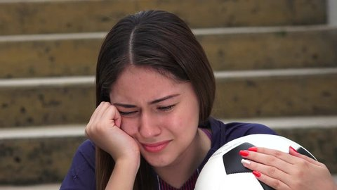 Athletic Teen Female Soccer Player Crying