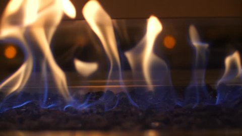 Fire flame flames in a modern fireplace roaring gas burning outdoors at night