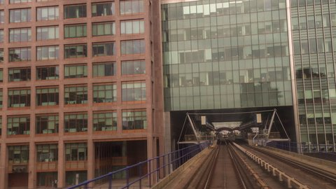 canary wharf in london, POV shot from the moving docklands light railway.