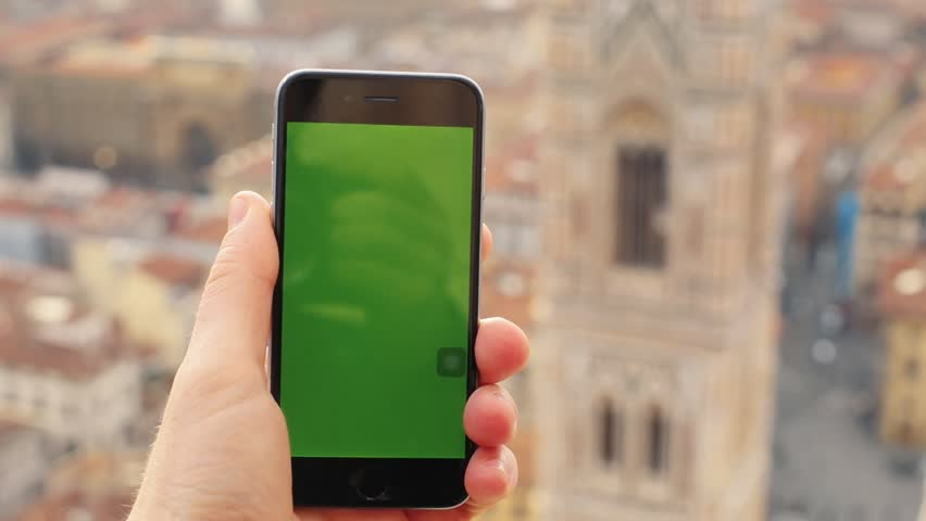 FLORENCE, ITALY - 4 APRIL 2017: Close up hand man hold phone with vertical green screen   | Shutterstock HD Video #1007474026