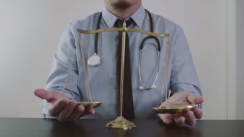 Medical law and justice. Health care balance.Lawyer or Doctor present his confidence in slow motion
