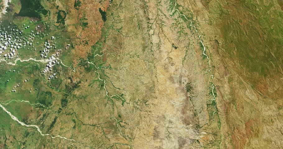 Very high-altitude overflight aerial of rivers and iron-rich terrain, western Madagascar . Clip loops and is reversible. Elements of this image furnished by NASA